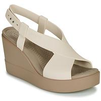 Čevlji  Ženske Sandali & Odprti čevlji Crocs CROCS BROOKLYN HIGH WEDGE W Bež