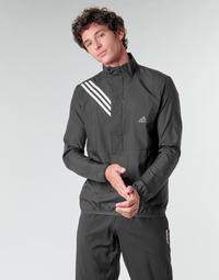 Oblačila Moški Puloverji adidas Performance OWN THE RUN JKT Črna