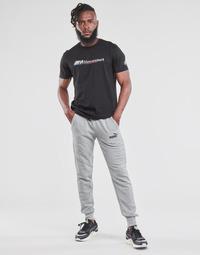 Oblačila Moški Spodnji deli trenirke  Puma ESS LOGO SLIM PANT LOGO FL CL Siva