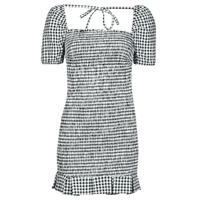 Oblačila Ženske Kratke obleke Guess AIDA  DRESS Črna / Bela