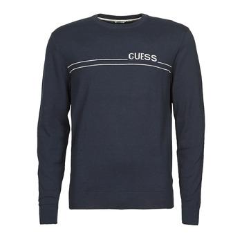 Oblačila Moški Puloverji Guess LS CN LOGO 12 GG Modra