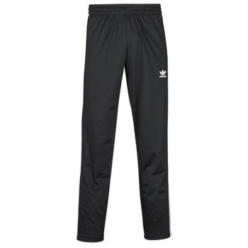 Oblačila Moški Spodnji deli trenirke  adidas Originals FIREBIRD TP Črna