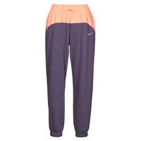 Oblačila Ženske Spodnji deli trenirke  Nike NSICN CLSH JOGGER MIX HR Vijolična / Rožnata