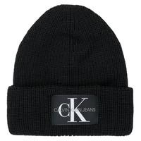 Tekstilni dodatki Ženske Kape Calvin Klein Jeans MONOGRAM BEANIE WL Črna